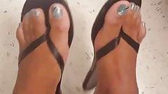 Sexy ebony toe wiggle flip flops