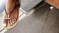 Candid ebony feet in sandals