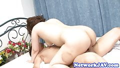 Redhead asian rides a huge coc