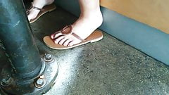 Candid of friend's feet in restaurant