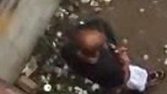 black guy hiding in the corner