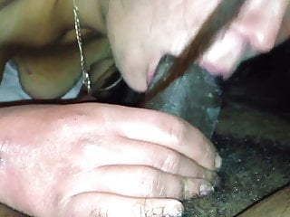 Licking and sucking her cum of the dick