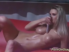 busty babe naked on public stage