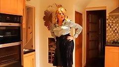 Light blue silky blouse and dark blue satin pleated skirt