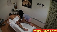 Asian babe oils up her clients cock