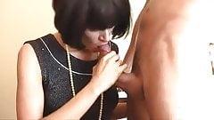 Elegant Woman sucking 2 hard cocks