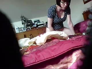 My horny mum using her toy on bed caught by hidden cam