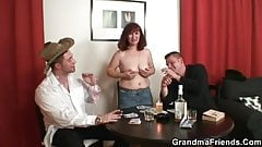 Granny swallowing two big cocks