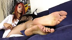 Barefoot Tattooed Redhead plays with her ballet flats's Thumb