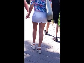 #74 Blonde girl with sexy legs in white mini skirt