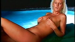 Big tit blonde with tattoo gets titty fucked and jizzed on out by the pool