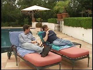 Cute brunette trollop fucks two guys by the pool