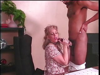 Mature blonde whore sucks an enormous black pole then fucks