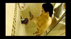 Big Tits Brunette takes a shower - Hidden Cam Clip