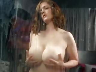 Spraying milk on to glass from her big udders