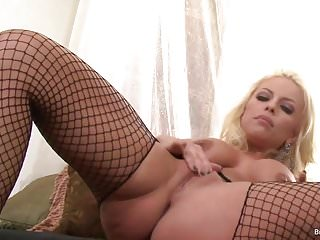Sexy blonde Britney Amber plays with her pussy