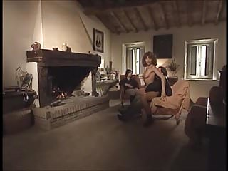 Two girls and a guy with the fireplace