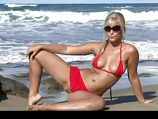 8968867 hot blonde stripping on the beach