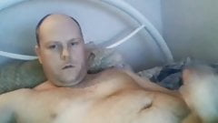 Handsome bald daddy shooting on face