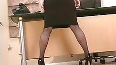 Gorgeous blonde in glasses plays with a dildo at work