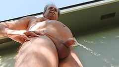 Naked daddy taking an early morning pee on his patio.