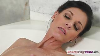 Masturbating stepmom caught in the bathtub