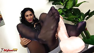 Brunette gives a footjob in Black Pantyhose