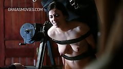 Slut bound with leather straps and punished with a riding cr