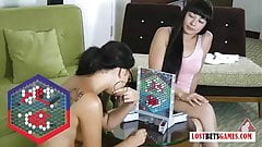 Two really pretty girls play a strip strategy game
