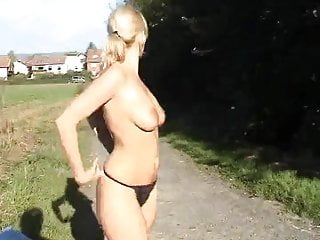 Blonde Girl Strips Naked In A Public Place