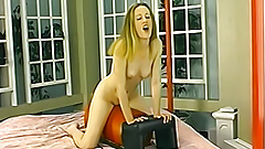 Petite amateur rides a sex machine until she orgasms