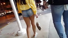 Candid voyeur teen showing off cheeks in short shorts