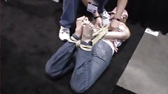Bondage demo on barefoot girl
