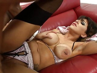Mesmerizing bimbo gets her pussy drilled severely on the sofa