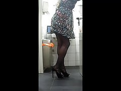 Secretary in toilet caressing the ass