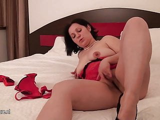 Amateur housewife playing with her pussy on bed