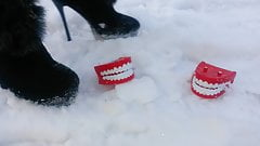 Winter crush: Lady L  crush teeth with sexy black boots.