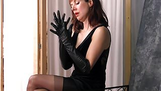 Posh british brunette Milf teases in nylons leather gloves