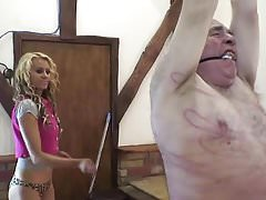Young blonde girl whips old fat man