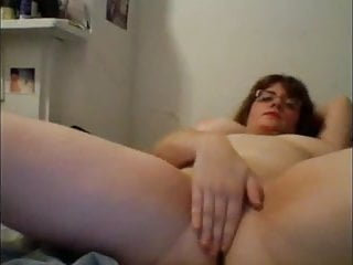 Chubby MILF rubs pussy on bed