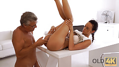 OLD4K. Old dad with glasses nails young pussy on the office