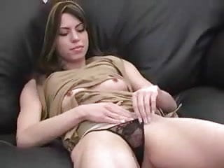 Cute young brunette rubs her pussy