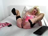 blonde crossdresser shooting cum