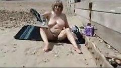 Older slut masturbating on a beach !