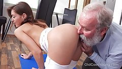 Juicy brunette works out in front of a curious old man