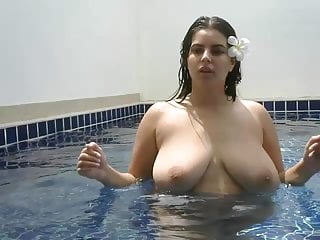 Beautiful girl shows her charms in the pool