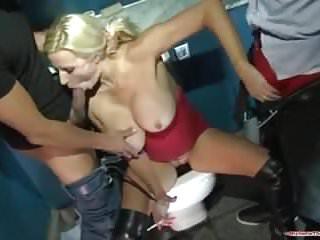 Blonde slut caught wanking in club toilet gets spit roasted