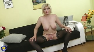 Mature mom with saggy tits feeding pussy