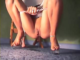 Nice pierced pussy pees the carpet wearing high heels 1