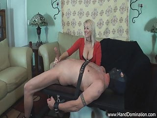 powerful woman controls massive cock during handjob milking
